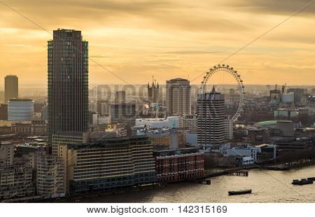 Sunset above central London with famous landmarks, skyscrapers and River Thames - London, UK