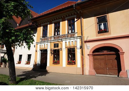 KEZMAROK SLOVAKIA - JULY 08 2016: Street with styled hotel old historical buildings with flowers in Kezmarok town High Tatras Slovakia