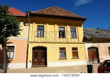 KEZMAROK SLOVAKIA - JULY 08 2016: The old yellow historical building with entrance gate in Kezmarok town High Tatras Slovakia.
