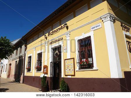 KEZMAROK SLOVAKIA - JULY 08 2016: The old yellow historical building of restaurant in Kezmarok town High Tatras Slovakia.