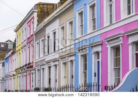 Traditional colorful brick houses of Notting Hill district near Portobello Road - London, UK