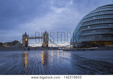 The world famous Tower Bridge with the City Hall building on an early winter morning - London, UK