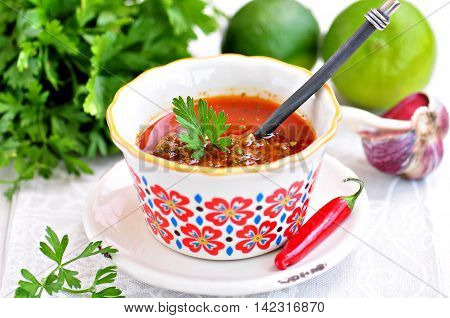 Sauce-marinade for fish or meat with coriander, parsley, cumin, chilli, olive oil and garlic.