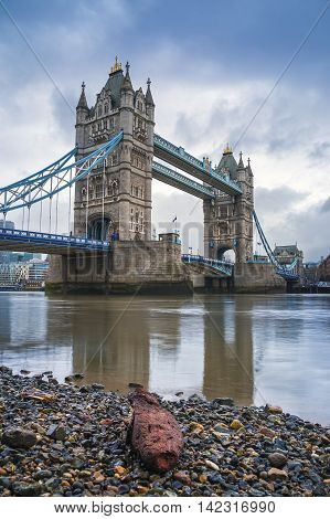 The iconic Tower Bridge in the morning with red rock - London, UK