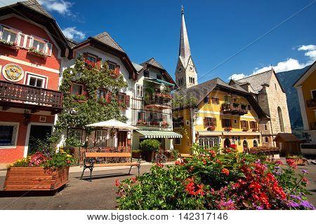 Town square in Hallstatt Austria. Hallstatt Village Central Square with flowers and istoric architecture.
