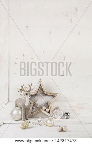 Shabby chic white beige christmas decoration with decoration in silver and grey for a greeting card.
