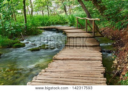 Wooden Road Trail in Plitvice National Park Croatia with Water Stream