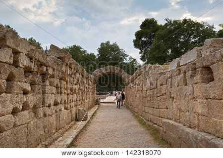 OLYMPIA, GREECE - AUGUST 08, 2016: Arched way to the stadium in the archaeological site of Ancient Olympia on August 08, 2016.