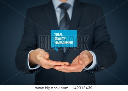 Total quality management concept. TQ manager hold virtual label with text TQM.