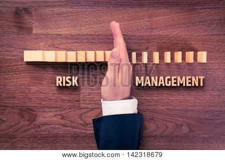 Risk management concept. Risk manager (or another business person) has problem solution. Businessman stop domino effect top view.