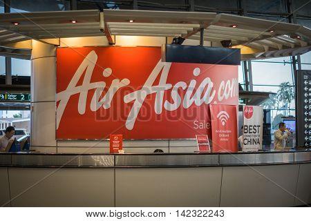 Kuala Lumpur, Malaysia - circa August 2016: Air Asia service counter at Kuala Lumpur International Airport, KLIA. AirAsia Berhad is a Malaysian low-cost airline headquartered near Kuala Lumpur, Malaysia.