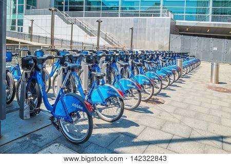 NEW YORK CITY, USA - JUNE 24, 2016: Station of Citi Bike near Battery Maritime Building