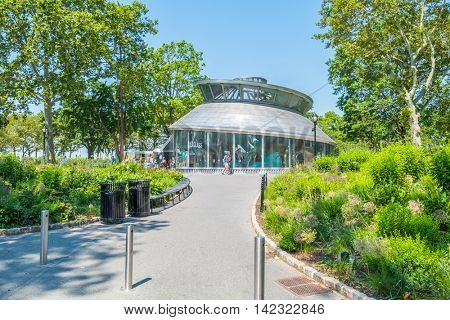 NEW YORK CITY, USA - JUNE 24, 2016: SeaGlass Carousel, a fish-themed carousel in Battery Park