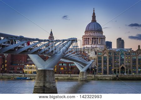 London, UK - Millennium Bridge with St.Paul's Cathedral at sunset with clear blue sky