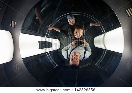 Active family traveling with 15 years child in carrier and explore Europe. Tourist in the elevator of Old Town Hall with Astronomical Clock in Prague Czech Republic.