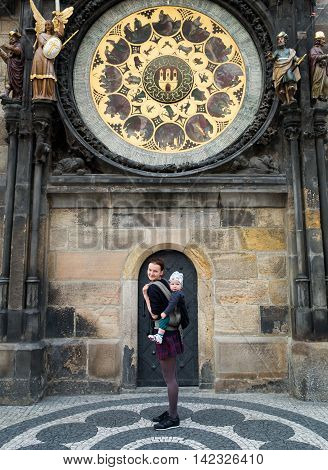 Family Of Tourists On The Background Of Tower Astronomical Clock, Prague, Czech Republic.