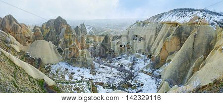 The snowbound valley among the cone peaked rocks of Goreme Cappadocia Turkey.