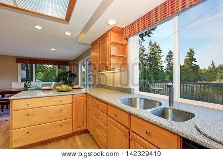 Bright Wooden Kitchen Interior With Granite Counter Tops