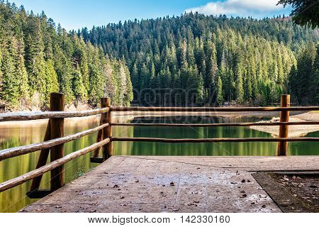 Pier On Mountain Lake