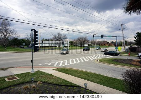 JOLIET, ILLINOIS / UNITED STATES - MARCH 19, 2016: A vehicle turns left onto the Wesmere Parkway from Caton Farm Road in Joliet.