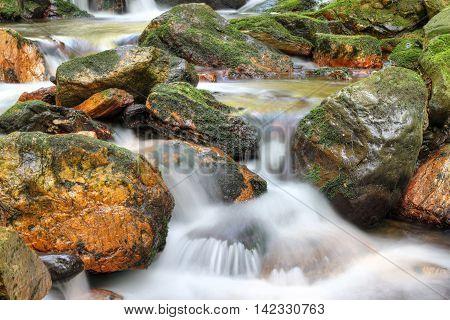 Water running over rocks - long exposure Bila Opava Czech republic