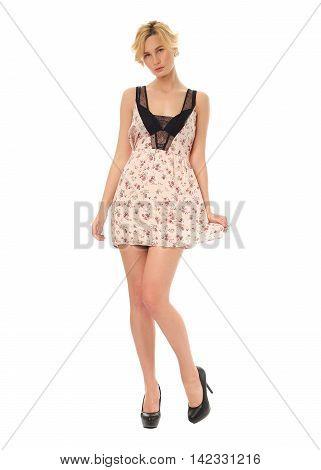 Fashion model wearing pink sundress isolated on white