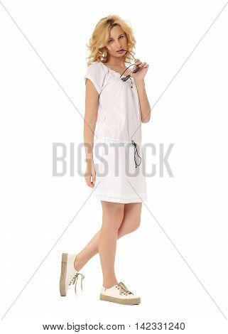 Fashion model wearing white sundress isolated on white