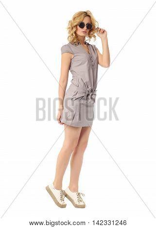 Fashion model wearing gray sundress isolated on white