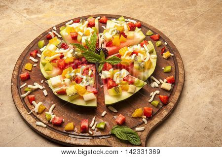 a composition composed of mixed fruits such as watermelon and peach.