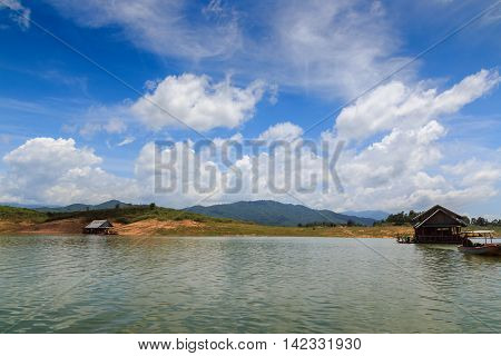View riverside with blue skyclouds and raft in countryside
