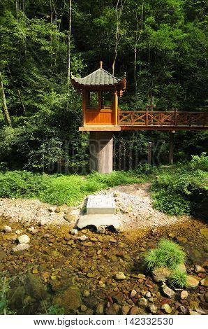 An asian gazebo on a cement post near the golden whip stream in Zhangjiajie National Forest in Hunan China.