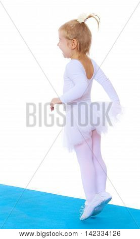 Cheerful little girl is a future gymnast, white sports dress, jumps on the blue track Mat-Isolated on white background