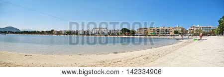 Alcudia Majorca Spain - June 26 2008: Beach panorama of Alcudia with hotels beach and water of mediterranean sea in front