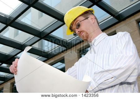 Architect With Architectural Plans