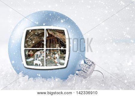 Christmas background with ball and the scene of the Nativity.