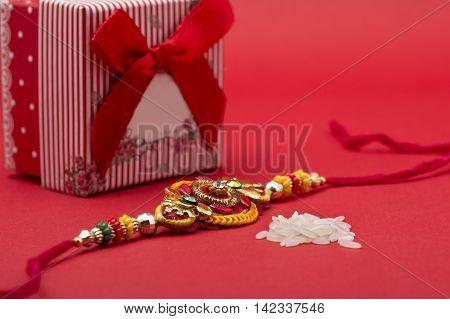 Indian festival: Raksha Bandhan background with Rakhi and Gift.