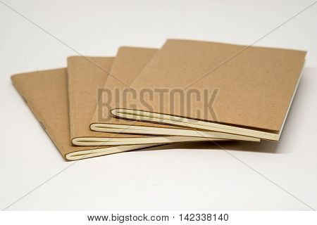 Group of brown booklet on the white background.