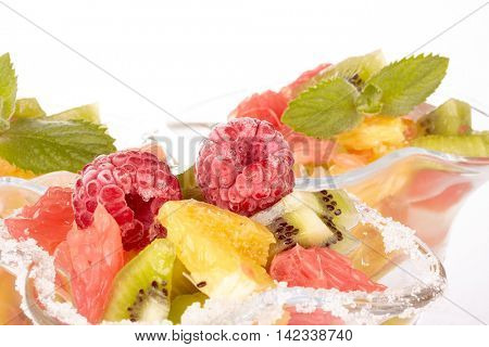 Fresh fruit salad on a white background. Dessert.