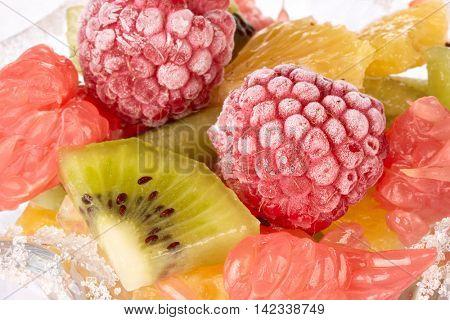 Background from appetizing fresh fruit salad. Dessert.