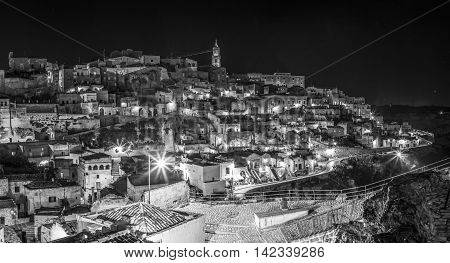 Panoramic nocturnal view of Matera Italy. The city is a UNESCO World Heritage site.