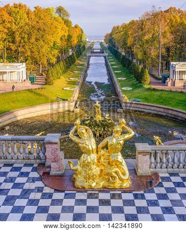 PETERHOF, RUSSIA - OCTOBER 17, 2015: Grand Cascade in Peterhof, St Petersburg, Russia on October 17, 2015. The Peterhof palace was included in the falls at an's World Heritage List in 1991.