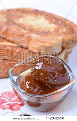 Fig jam and fried bread slices. Bulgarian breakfast.