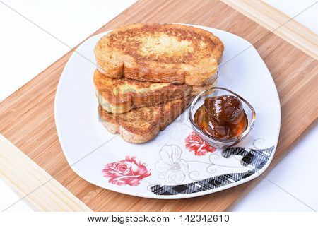 Fried bread slices and fig jam. Bulgarian breakfast.