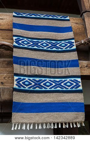 Traditional Bulgarian woven rug on the balcony of the wooden house in Etara village Bulgaria