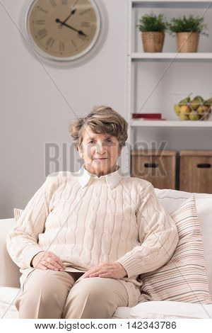 Elderly Woman Resting On Couch