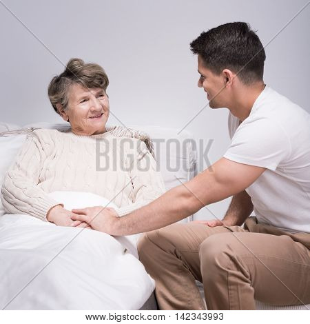 Man Helping His Ill Grandmother