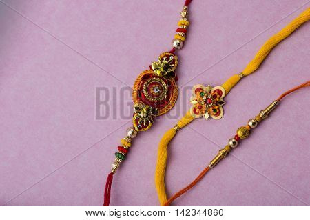Indian festival: Raksha Bandhan background with Rakhi.