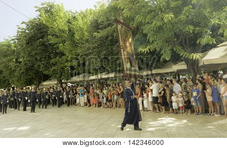 CORFU, GREECE - AUGUST, 12, 2016: Clerics and philharmonic musicians in the customary lament procession on the Saint Spyridon celebration , at the old town of Corfu.