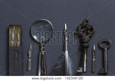 Vintage writing set on a gray cardboard background