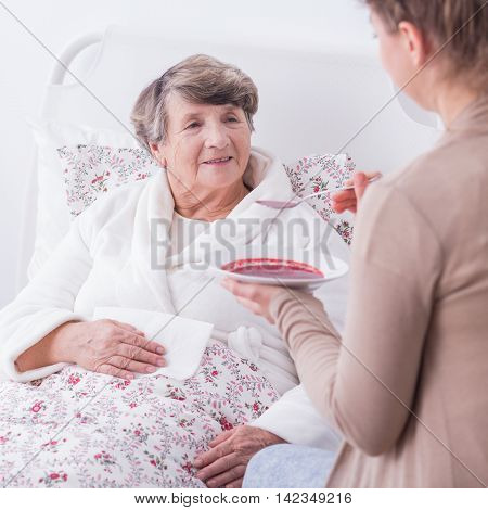 Granddaughter Helping Her Ill Grandmother